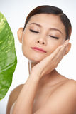 Natural beauty. Young woman using natural skincare products for her face Stock Images