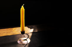 Natural beeswax candle and copy space Stock Image