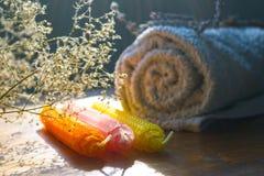 Natural beeswax candles and spa towel Stock Photos