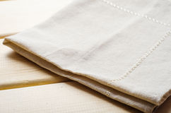 Natural beige cotton cloth on wooden table Royalty Free Stock Photos