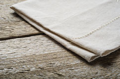 Natural beige cotton cloth on wooden table Royalty Free Stock Image