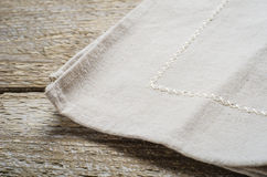 Natural beige cotton cloth on wooden table Royalty Free Stock Photography