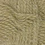 Natural beige fine wool threads texture, clew pattern macro closeup, large detailed background Stock Photography