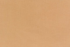 Natural beige linen fabric for the background. Close-up view of Royalty Free Stock Photography