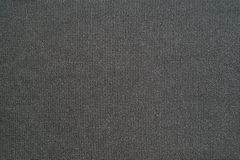 Natural black background of synthetic fabric Royalty Free Stock Photos