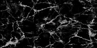 Natural black marble texture for skin tile wallpaper luxurious background, for design art work. Stone ceramic art wall interiors b. Ackdrop design. Marble with stock photo