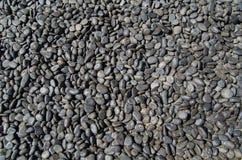 Black Stones Background. Natural black stones for background. Thousands of grey stones. Stones. Stones stock image