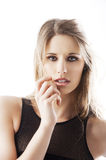 Natural blond woman, her hand is near the face Royalty Free Stock Photos