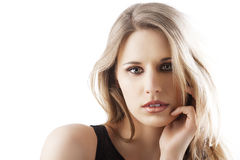 Natural blond woman with left hand near the face Royalty Free Stock Photo