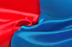 Natural blue and red satin fabric texture. Natural blue and red satin fabric as background texture Royalty Free Stock Photo
