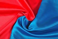 Natural blue and red satin fabric texture. Natural blue and red satin fabric as background texture Stock Photos
