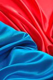 Natural blue and red satin fabric texture. Natural blue and red satin fabric as background texture Royalty Free Stock Photos