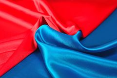 Natural blue and red satin fabric texture. Natural blue and red satin fabric as background texture Stock Photo