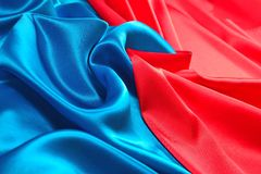 Natural blue and red satin fabric texture. Natural blue and red satin fabric as background texture Stock Image