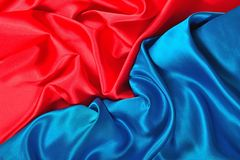 Natural blue and red satin fabric texture. Natural blue and red satin fabric as background texture Royalty Free Stock Image