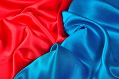Natural blue and red satin fabric texture. Natural blue and red satin fabric as background texture Royalty Free Stock Photography