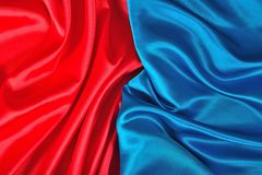 Natural blue and red satin fabric texture. Natural blue and red satin fabric as background texture Stock Images