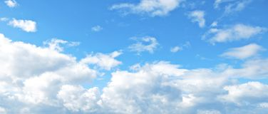 Natural blue sky with white clouds background. Close up to Stock Photography