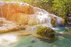 Natural blue stream waterfall in deep forest. Landscape background royalty free stock photos