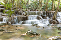 Natural blue stream waterfall in tropical deep forest Stock Images