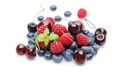 Blueberry, cherry and raspberry berries isolated on white background. Natural blueberry, cherry and raspberry berries isolated on white background. copy space Royalty Free Stock Image