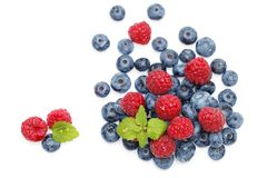 Blueberry and raspberry berries isolated on white background. Natural blueberry and raspberry berries isolated on white background. copy space Royalty Free Stock Photo