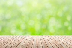 Natural blurred green summer background with wooden table. Natural blurred green summer background with wooden top table in foreground concept, copy space stock photos