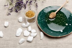 Natural body care and aromatherapy products on grey fabric. Close-up view of natural body care and aromatherapy products on grey fabric Royalty Free Stock Photo