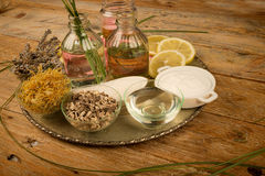 Natural body lotions assortment. Assortment of natural cosmetics on a rustic table Stock Images