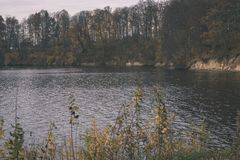 Natural body of water. pond with reflections - vintage retro loo. Natural body of water. pond with reflections of trees and clouds in calm water surface royalty free stock photos
