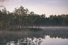 Natural body of water. pond with reflections - vintage retro loo. Natural body of water. pond with reflections of trees and clouds in calm water surface stock photo