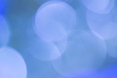 Natural bokeh on blue background Stock Photo