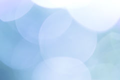 Natural bokeh on blue background Stock Photography