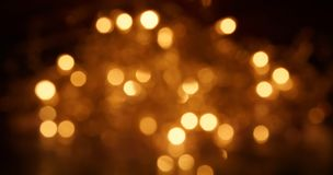 Natural bokeh holiday lights background bright lights. Natural bokeh holiday lights background for design stock image