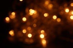 Natural bokeh holiday lights background bright lights. Natural bokeh holiday lights background for design stock photos