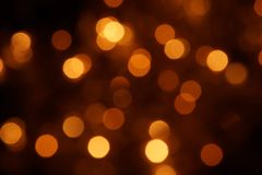Natural bokeh holiday lights background bright lights gold. Natural bokeh holiday lights background for design gold royalty free stock photos