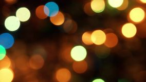 Natural bokeh holiday lights background bright lights green yellow lights of the Christmas tree stock footage