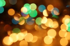 Natural bokeh holiday lights background bright lights green yellow blue party city. Natural bokeh holiday lights background for design green yellow blue party stock photos