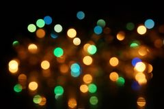 Natural bokeh holiday lights background bright lights green yellow blue party city. Natural bokeh holiday lights background for design green yellow blue party royalty free stock photography