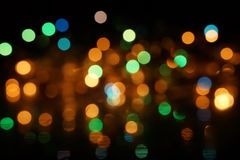 Natural bokeh holiday lights background bright lights green yellow blue party city. Natural bokeh holiday lights background for design green yellow blue party royalty free stock images