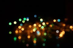 Natural bokeh holiday lights background bright lights green yellow blue party city. Natural bokeh holiday lights background for design green yellow blue party royalty free stock photo