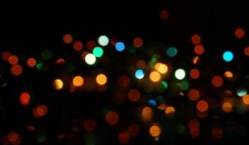 Natural bokeh holiday lights background bright lights green yellow blue party city. Natural bokeh holiday lights background for design green yellow blue party royalty free stock photos