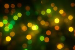 Natural bokeh holiday lights background bright lights green yellow. Natural bokeh holiday lights background for design green yellow royalty free stock photography