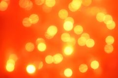 Natural bokeh holiday lights background bright lights orange. Natural bokeh holiday lights background for design orange stock photos