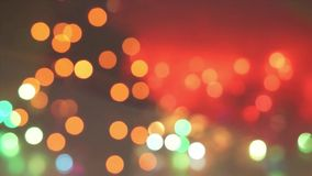 Natural bokeh holiday lights background bright lights Christmas tree in the city lights stock video footage