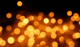 Natural bokeh holiday lights background bright lights gold. Natural bokeh holiday lights background for design gold stock photos