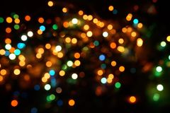 Natural bokeh holiday lights background bright lights green yellow blue party city. Natural bokeh holiday lights background for design green yellow blue party stock images