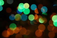 Natural bokeh holiday lights background bright lights green yellow blue party city. Natural bokeh holiday lights background for design green yellow blue party stock photography