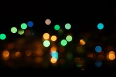 Natural bokeh holiday lights background bright lights green yellow blue party city. Natural bokeh holiday lights background for design green yellow blue party stock image