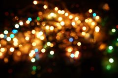 Natural bokeh holiday lights background bright lights green yellow blue party city. Natural bokeh holiday lights background for design green yellow blue party stock photo